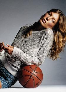 Daria Werbowy reclining atop a basketball