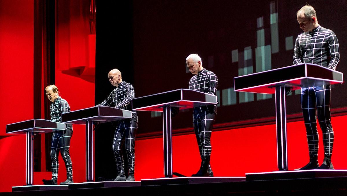 The band Kraftwerk performs live.