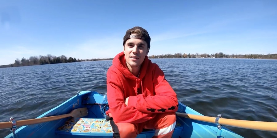 Justin Bieber in a rowboat.