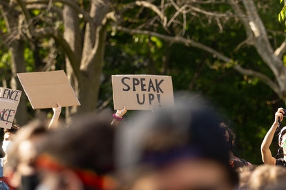 """A protest sign that reads """"Speak Up"""""""