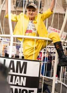 Vivienne Westwood climbing a cage