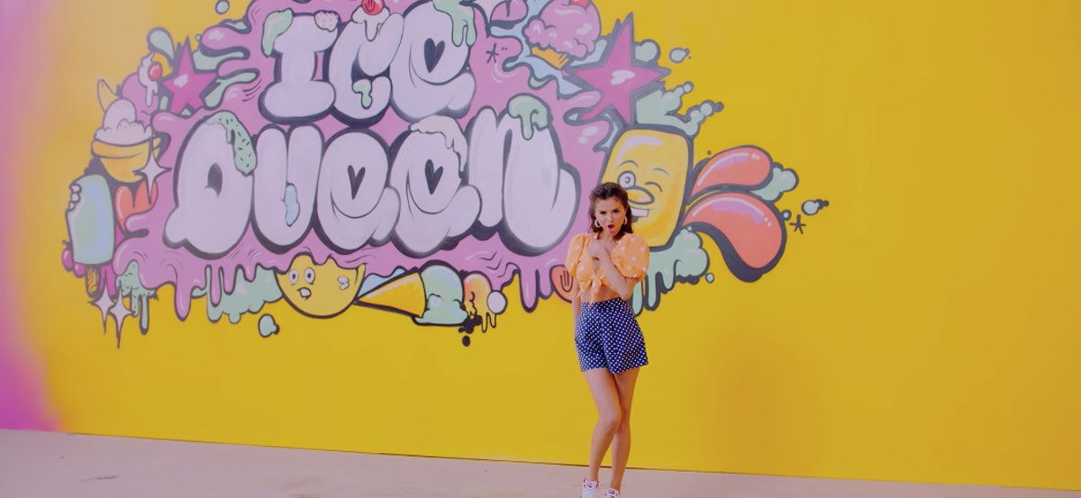 selena gomez in front of yellow wall