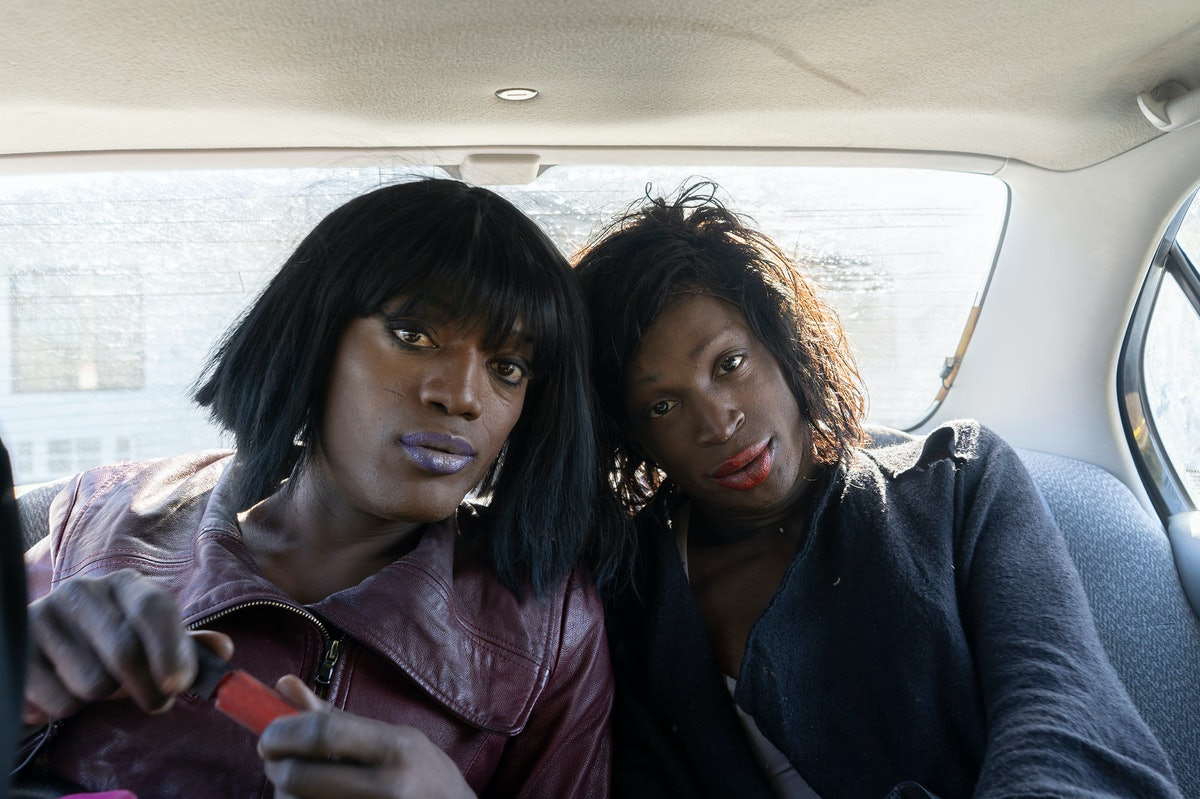 Two people sitting in the backseat of a car