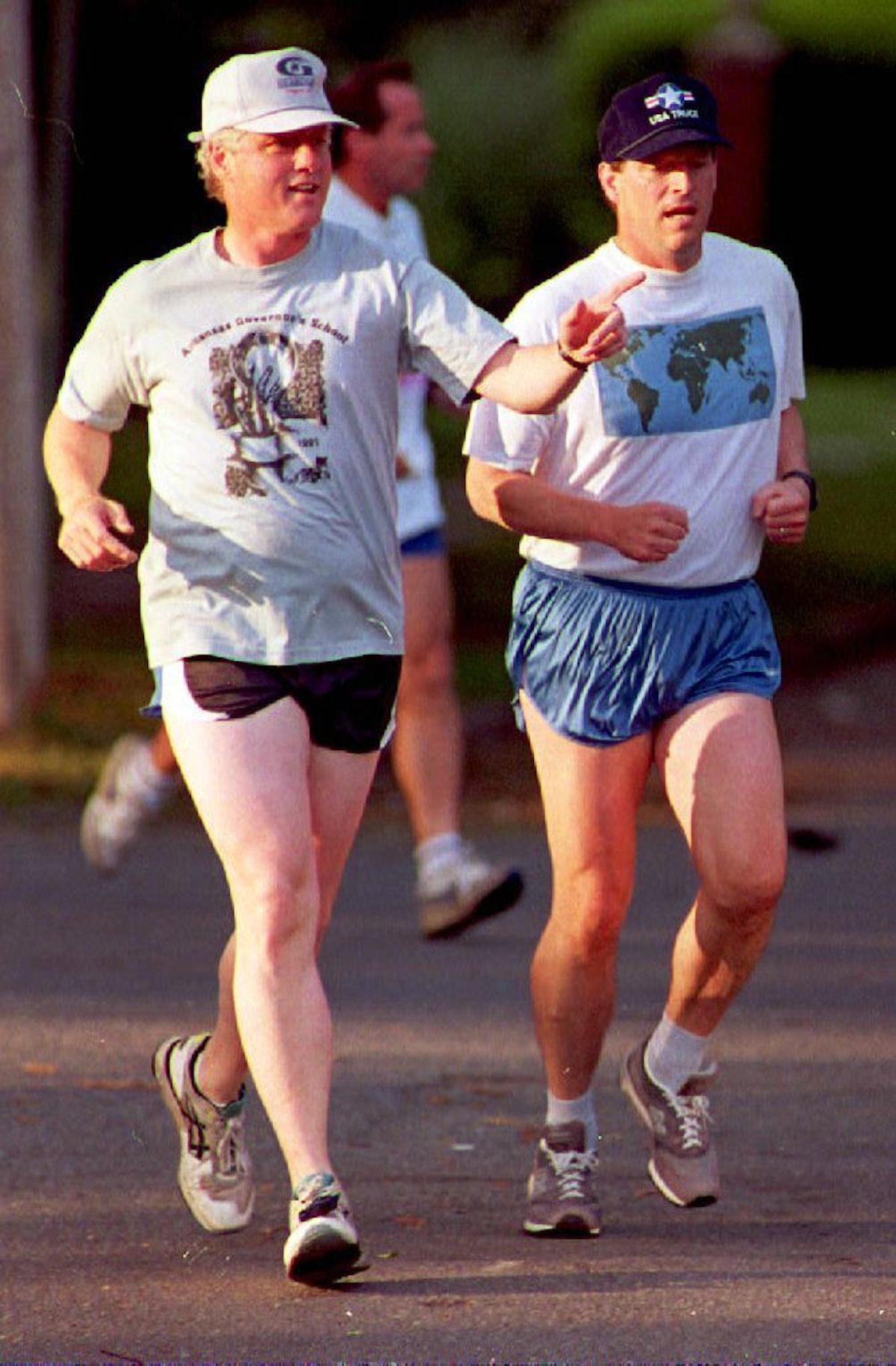 Bill Clinton and Al Gore jog.