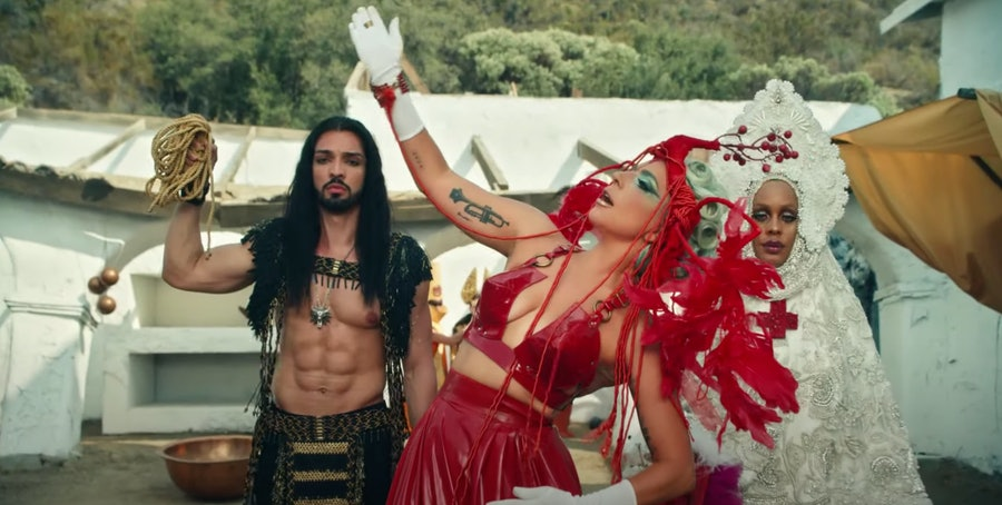 Lady Gaga with man with abs.
