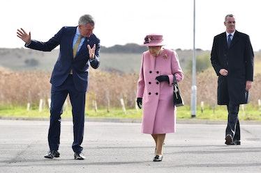 Queen Elizabeth II talking to a man