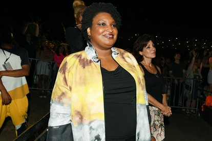 Stacey Abrams in yellow coat.