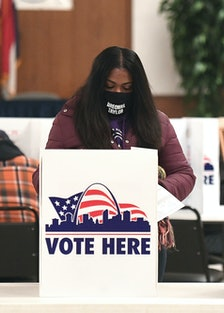 A person voting