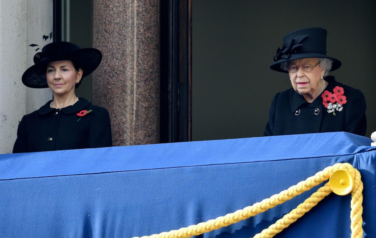 Susan Rhodes and Queen Elizabeth II on a balcony