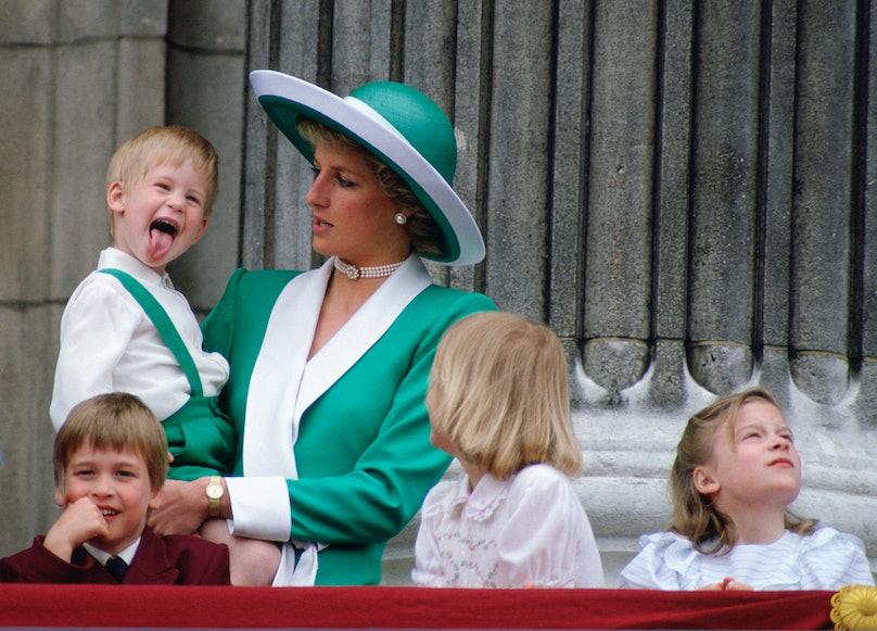 Prince Harry and Princess Diana on a balcony