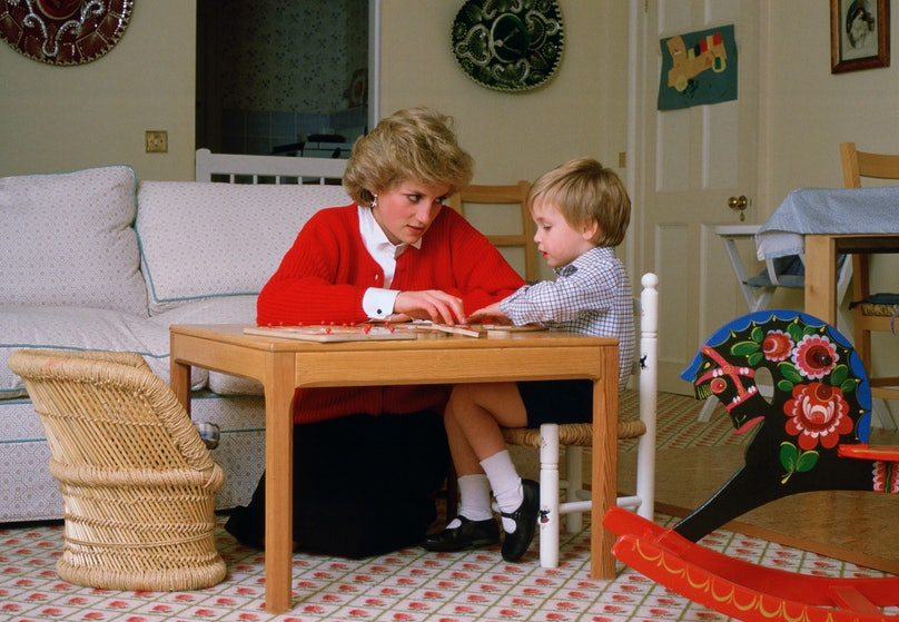 Princess Diana and Prince William working on a puzzle