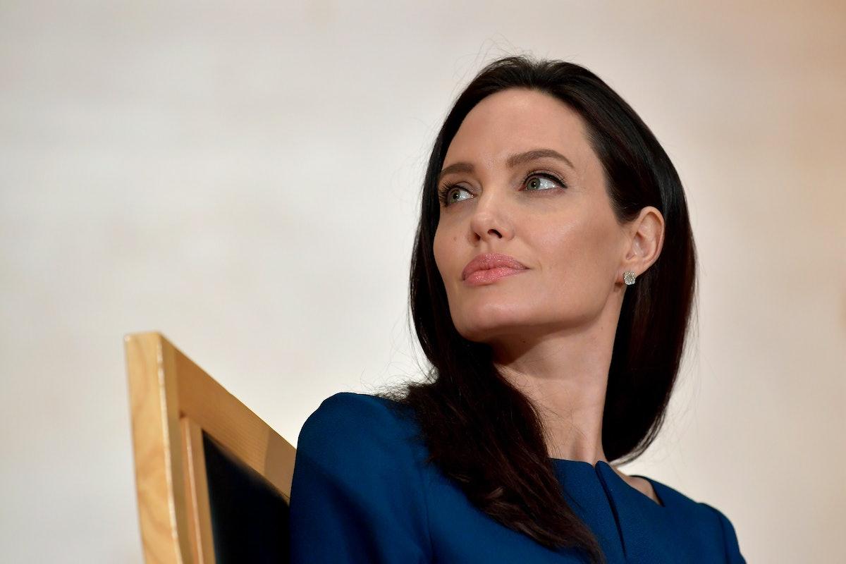 Angelina Jolie looks over shoulder.