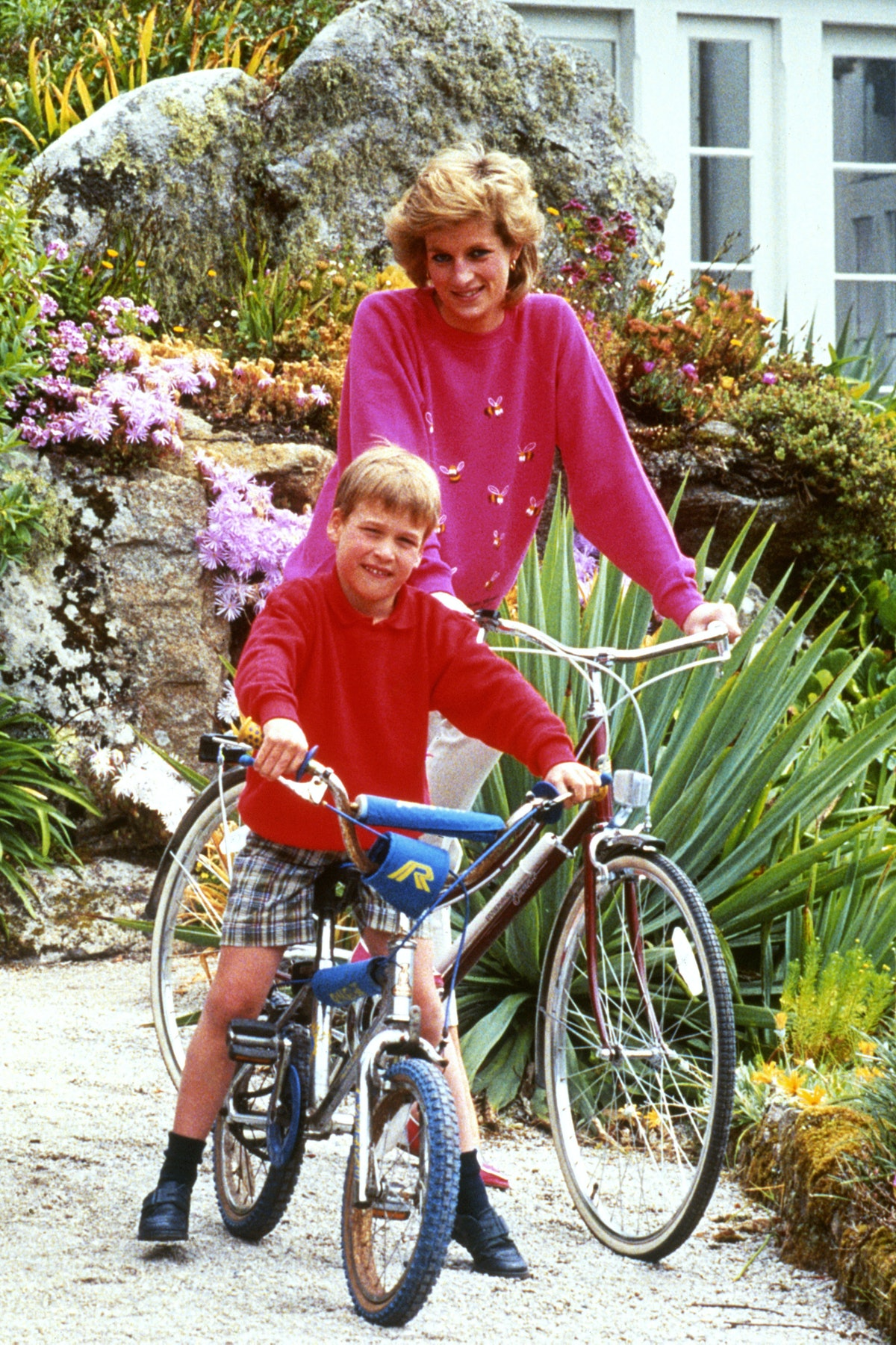 Prince William and Princess Diana on bikes
