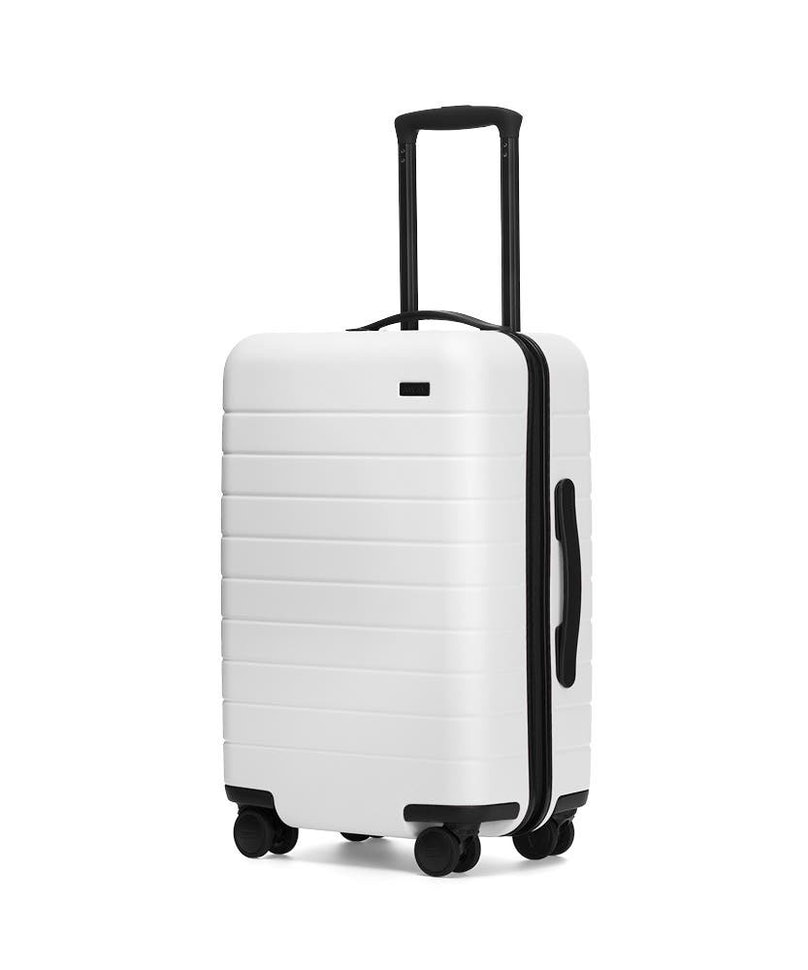 A white Away suitcase