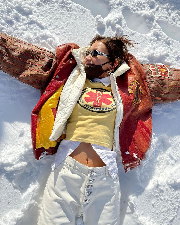 bella hadid making snow angels
