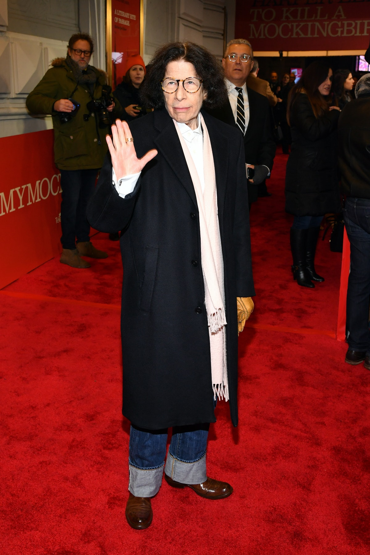Fran Lebowitz holding up her hand