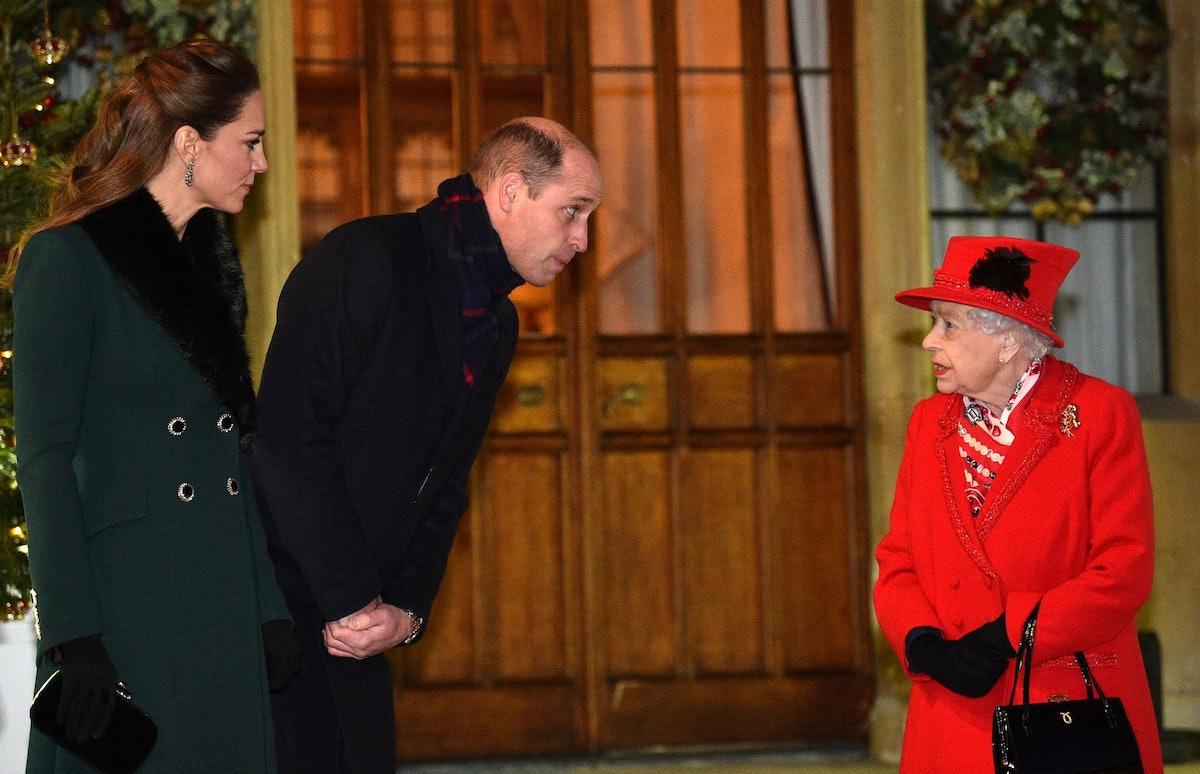 Prince William leaning towards Queen Elizabeth II