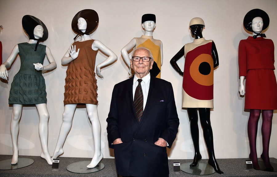 Pierre Cardin in front of his designs.