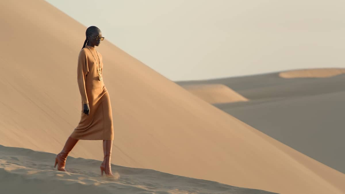 A YSL model in a sand dune