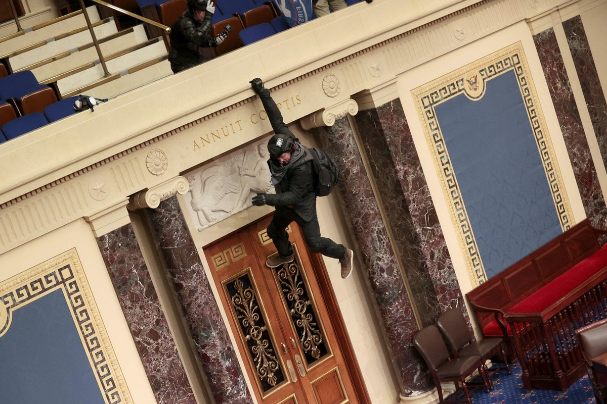 A terrorist scaling the walls of the Capitol