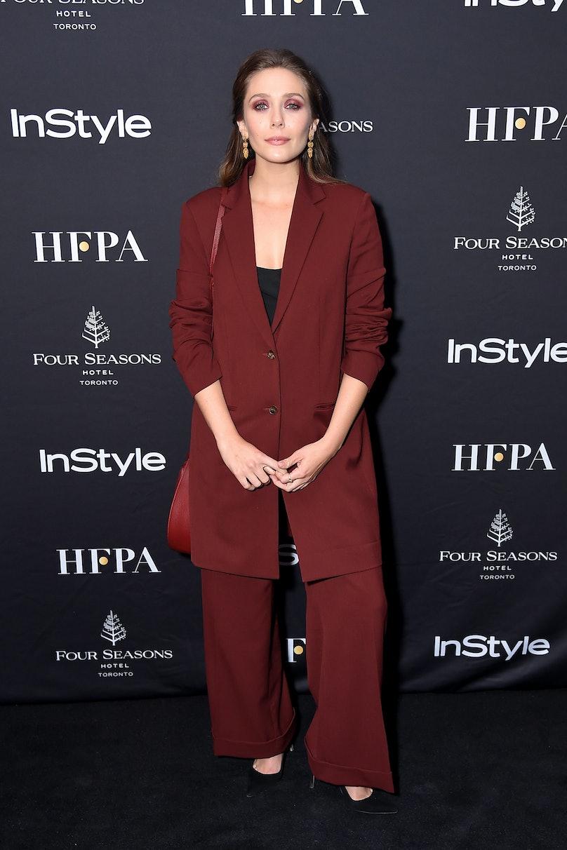 Elizabeth Olsen in burgundy suit.