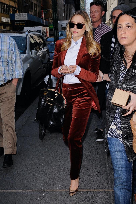 Elizabeth Olsen in an orange velvet suit.