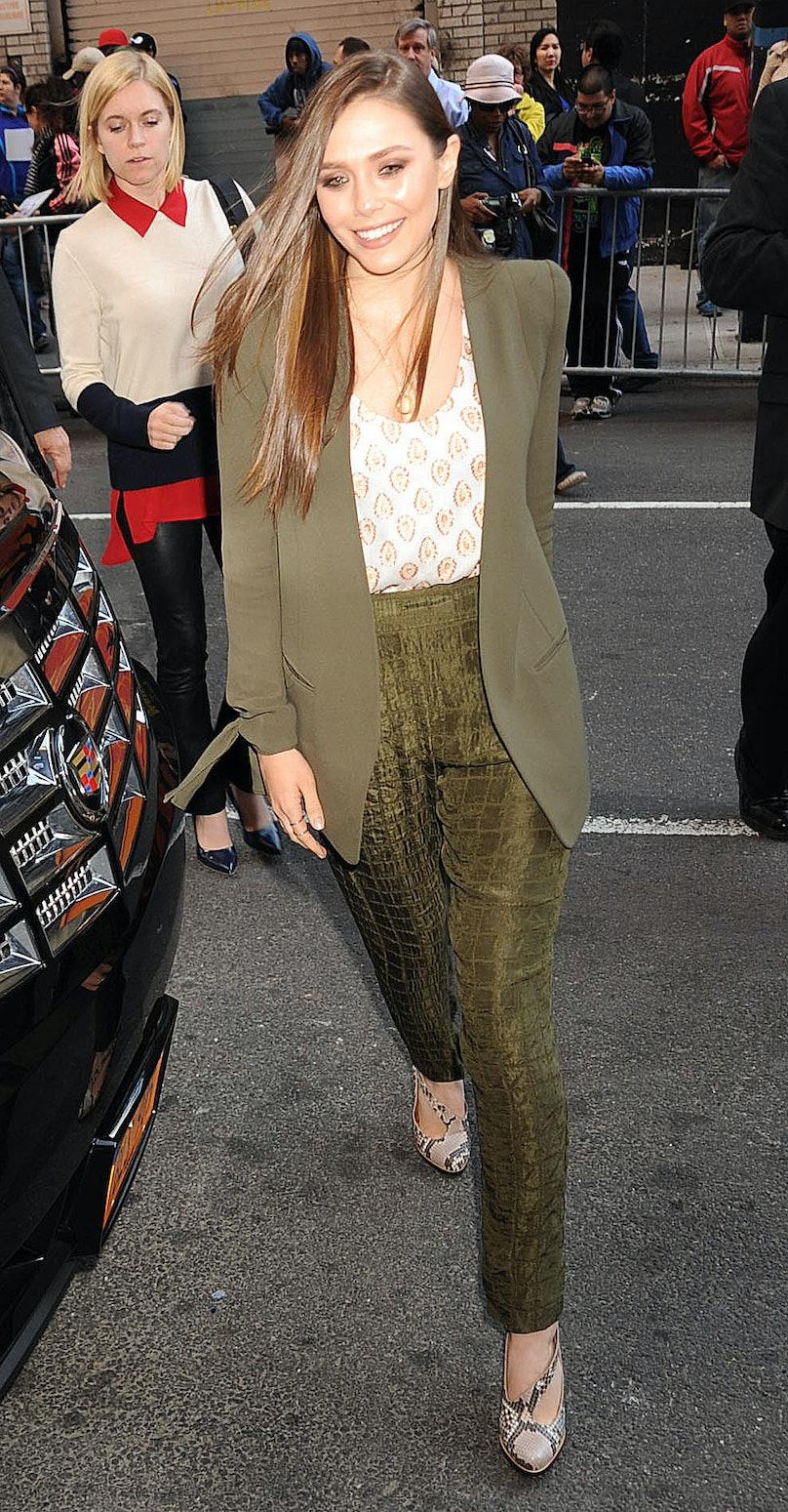 Elizabeth Olsen in green suit.