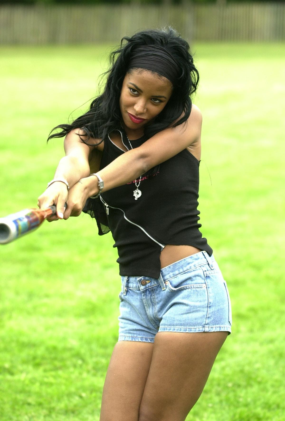 Aaliyah swinging a bat