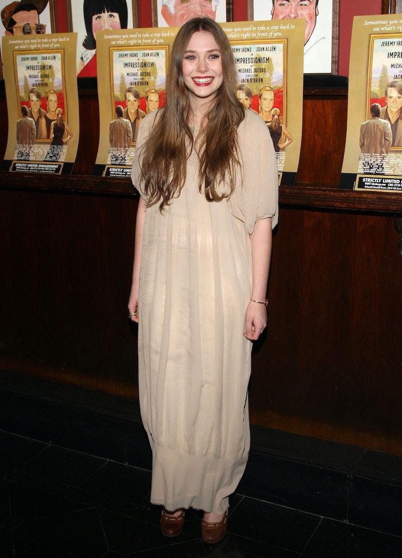 Young Elizabeth Olsen in a beige dress.
