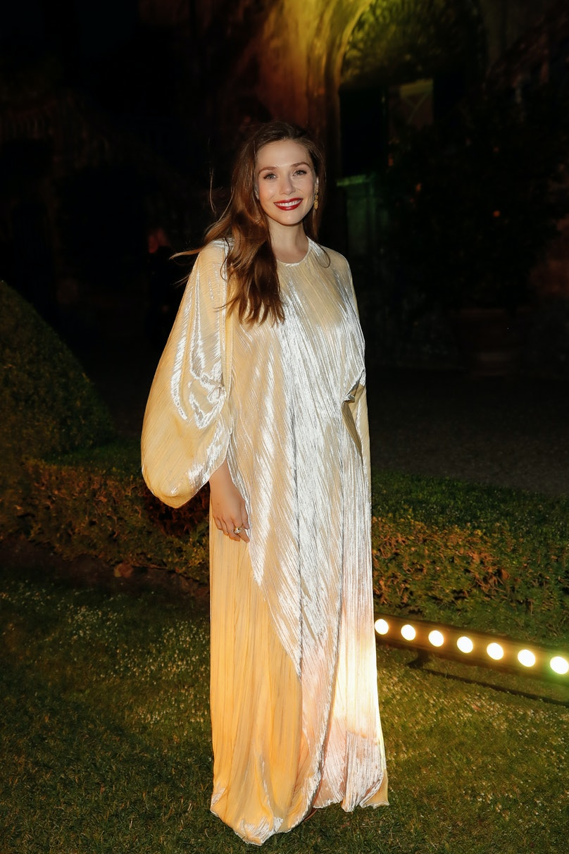 Elizabeth Olsen in billowing gold gown.