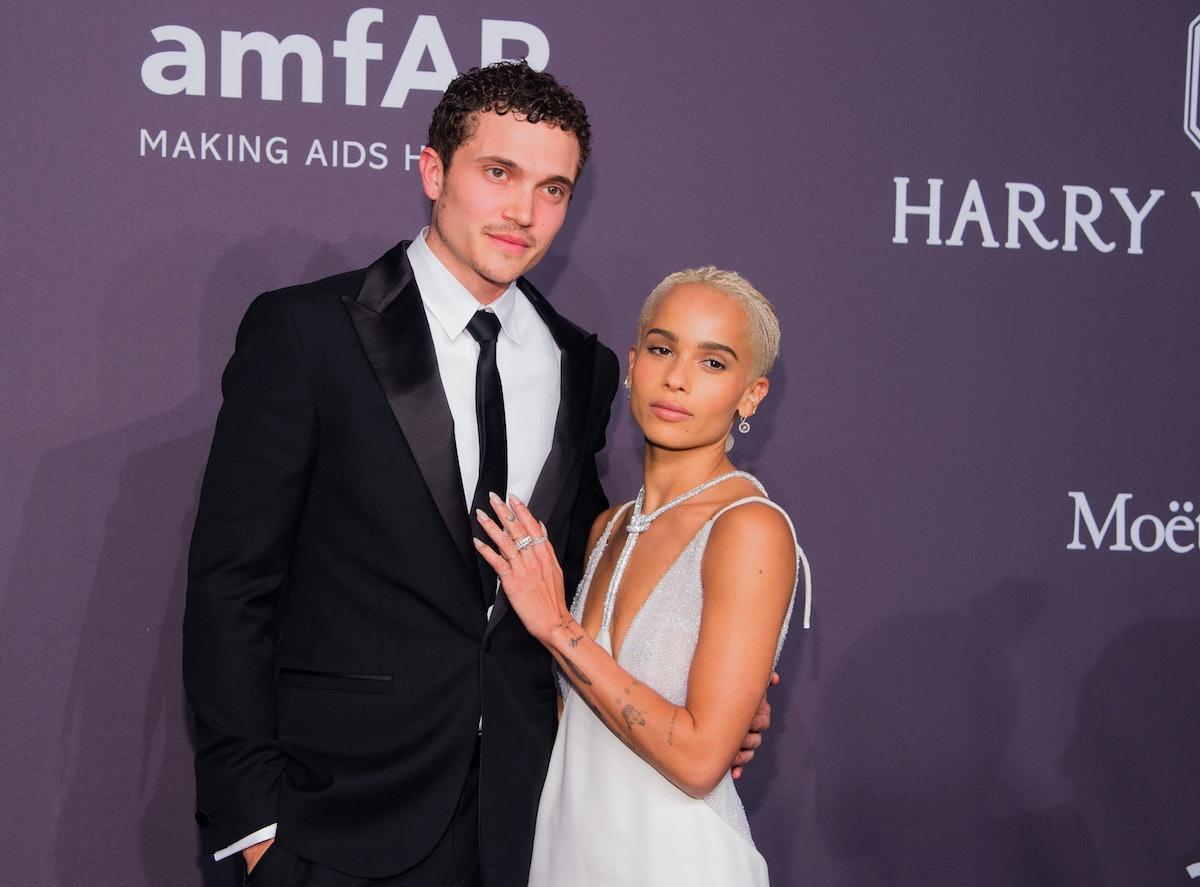Karl Glusman and Zoe Kravitz in black tie.