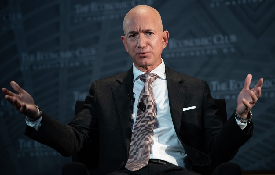 Jeff Bezos and his outstretched hands.