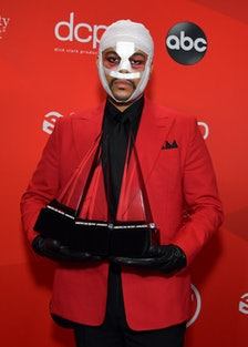 The Weeknd with face bandages.
