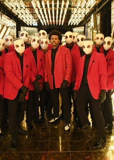The Weeknd in gold halftime room.