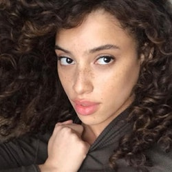 Khadijha posed selfie with curls and freckles