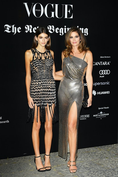 Kaia Gerber and Cindy Crawford wear matching mommy-and-me gowns at the Vogue Italia 'The New Beginning' Party during Milan Fashion Week Spring/Summer 2018 on September 22, 2017.