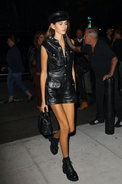 Kaia Gerber arrives at the Mert & Marcus book launch party on September 7, 2017 in New York City, wearing a leather jumpsuit from Manokhi and a mini tote bag from Stalvey.