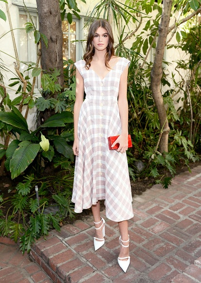 Kaia Gerber wears a checkered Veronica Beard dress while attending the CFDA/Vogue Fashion Fund Show and Tea Chateau Marmont on October 25, 2017 in Los Angeles, California.